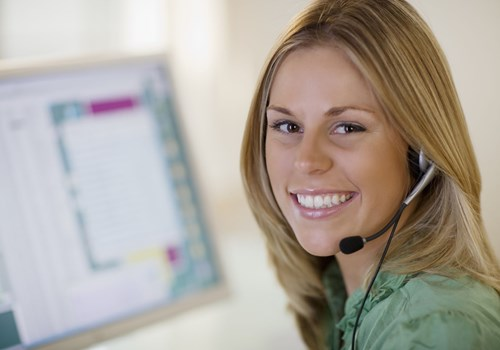 A female receptionist smiling at the camera